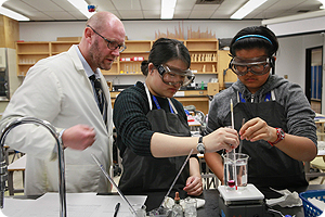 Teacher and students in science lab